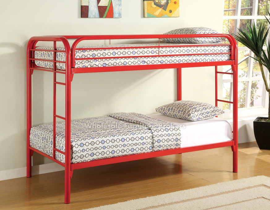 red metal bunk bed for small space design with white bedding aside potted  plants on wooden