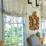 Relaxed Gorgeous Soft Blue Roman Shades Outside Mount For Traditional Vibe Living Room With Antique Wall Mirrors And Matched Soft Blue Chairs