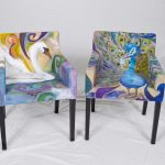retro style painting fabric furniture idea on two armchairs with blue base color with unique pattern with black legs