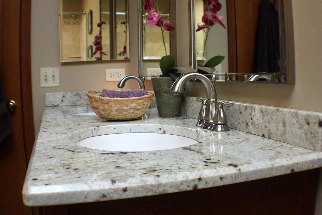 River White Granite Countertop In Small Bathroom With Round Sink And Curve  Faucet And Wall Mirror
