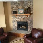 rug chairs stone fireplace