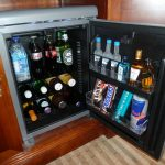 silver built-in mini fridge natural brown wooden cabinet cool drinks chocolates