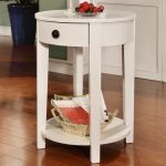 simple and classic white skinny side table idea with drawer and bottom storage and rattan basket on wooden floor