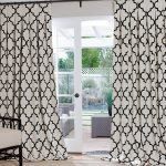 simple and minimalist window treatment white patterned curtains installed on glass door in the entrace of the house