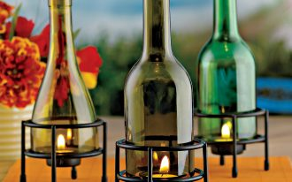 simple and smart wine bottle decorating ideas for lighting design with refined iron stove on yellow tray