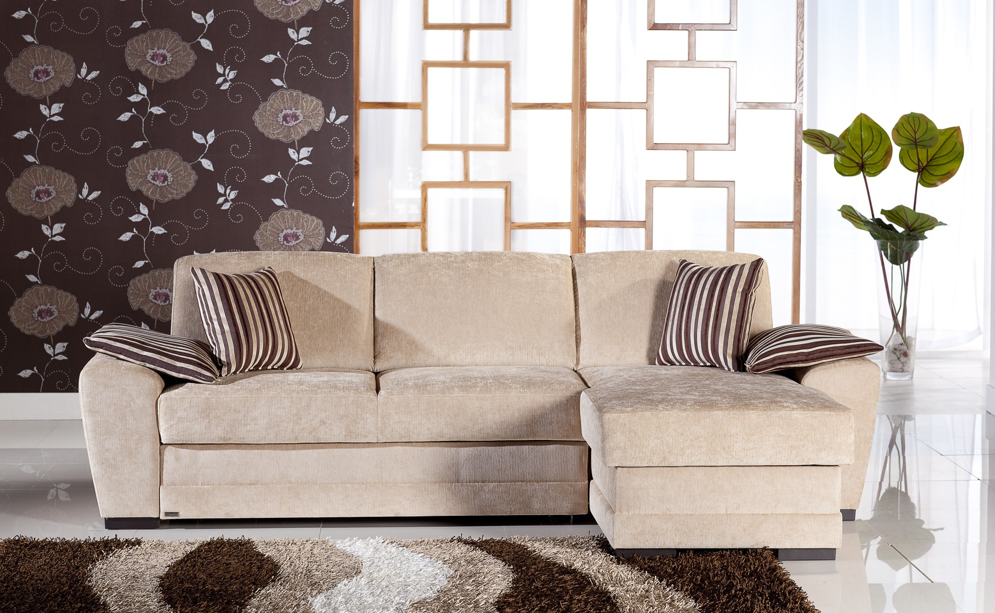 Beau Simple Beige Soft Sectional Sofa Sleepers With Stripe Cushions Flower Walls  Green Plants Two Tones Rug