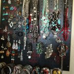 simple black red flower motive pegboard jewelry display beautiful colorful etnic stone jewelries necklaces earrings bracelets