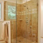 simple glass enclosed showers walnut tile walls and floor walnut hanging towels