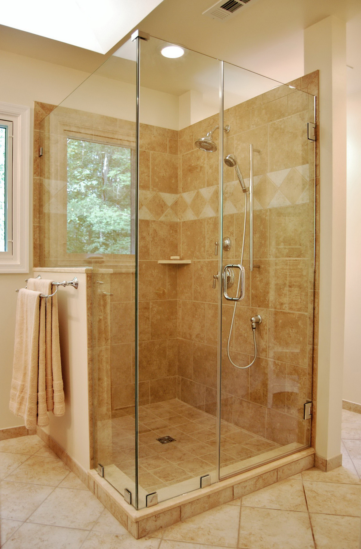 Benefits of Glass Enclosed Showers HomesFeed : simple glass enclosed showers walnut tile walls and floor walnut hanging towels from homesfeed.com size 1176 x 1789 jpeg 558kB