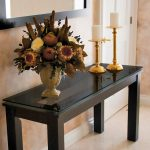 simple sleek black wood glass long console tables beautiful decorative flower vase gold candles beige tile floor