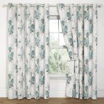 simple window treatment with white patterned curtains in combination with blue floral pattern together with wooden floor