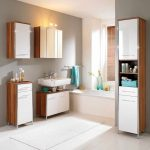 skandinavian ikea bath cabinet design in beige and white color with floating sink and wall storage aside white tub