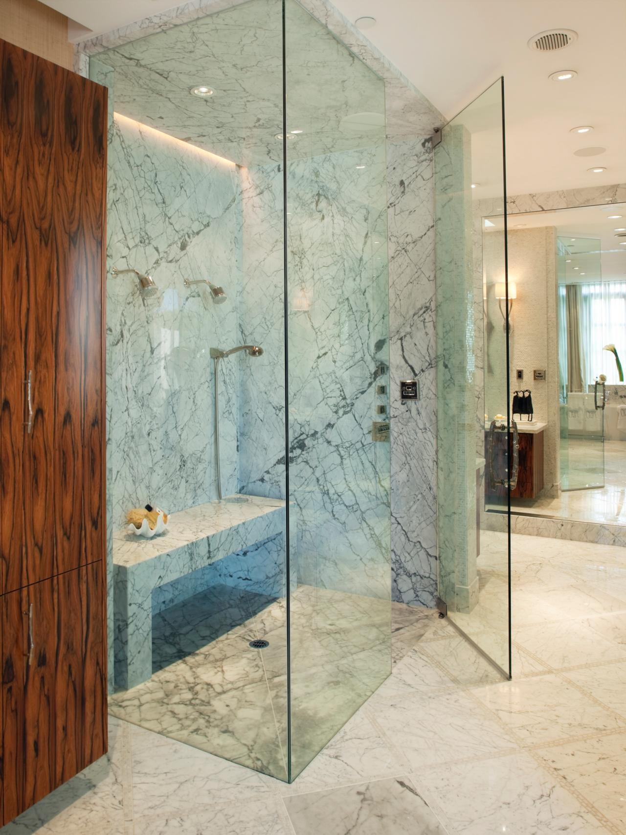 sleek frameless glass enclosed showers modern granite bathroom brown wooden  bathroom closet
