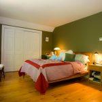 sleek red pine flooring bedroom wooden bed frame lime green walls pink red bedsheet