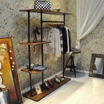 smart interior design with white wallpaper idea and vintage wardrobe storage with iron pirpe furniture for shoes and large painting idea and white sheer curtain