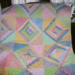 smooth colored baby quilt to make idea with triangle pattern in pink blue green and purple colros