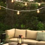 sofas candle lamps lights string pillows plants table garden