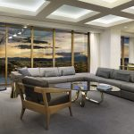 sofas chairs table tv ceiling windows lamps