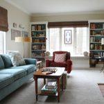 sofas pillows shader shelf lamp pics books fireplace