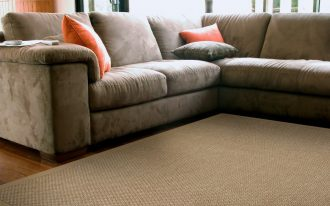 soft sisal rug in livinng room decorated on wooden floor and sectional sofa plus comfy cushions for affectionate living room