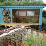 sophisticated small shipping container design for living space with black chair and wall texture aside small garden