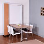 sophisticated space saver dining set with rectangular dining table with wooden top and stylish white chair with black cushion plus brown rug on the top of wooden floor