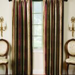 sound reducing curtains in tuscan decorated with comfy chairs and candle holder on wall and wooden laminate floor