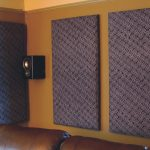 soundproofing an apartment theatre room with motive gray acoustic panels beside speakers