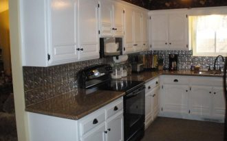 space saver microwave for kitchen with white wooden kitchen cabinet plus granite countertops plus window above the kitchen sink and modern backsplash