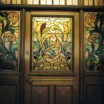 stained glass door with stained glass side windows with floral pattern