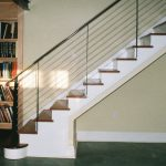 stairs books wood cabinet floor wall