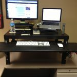 standing desk table wood board monitor laptop keyboard