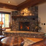 stone fireplace country home lamp chair table