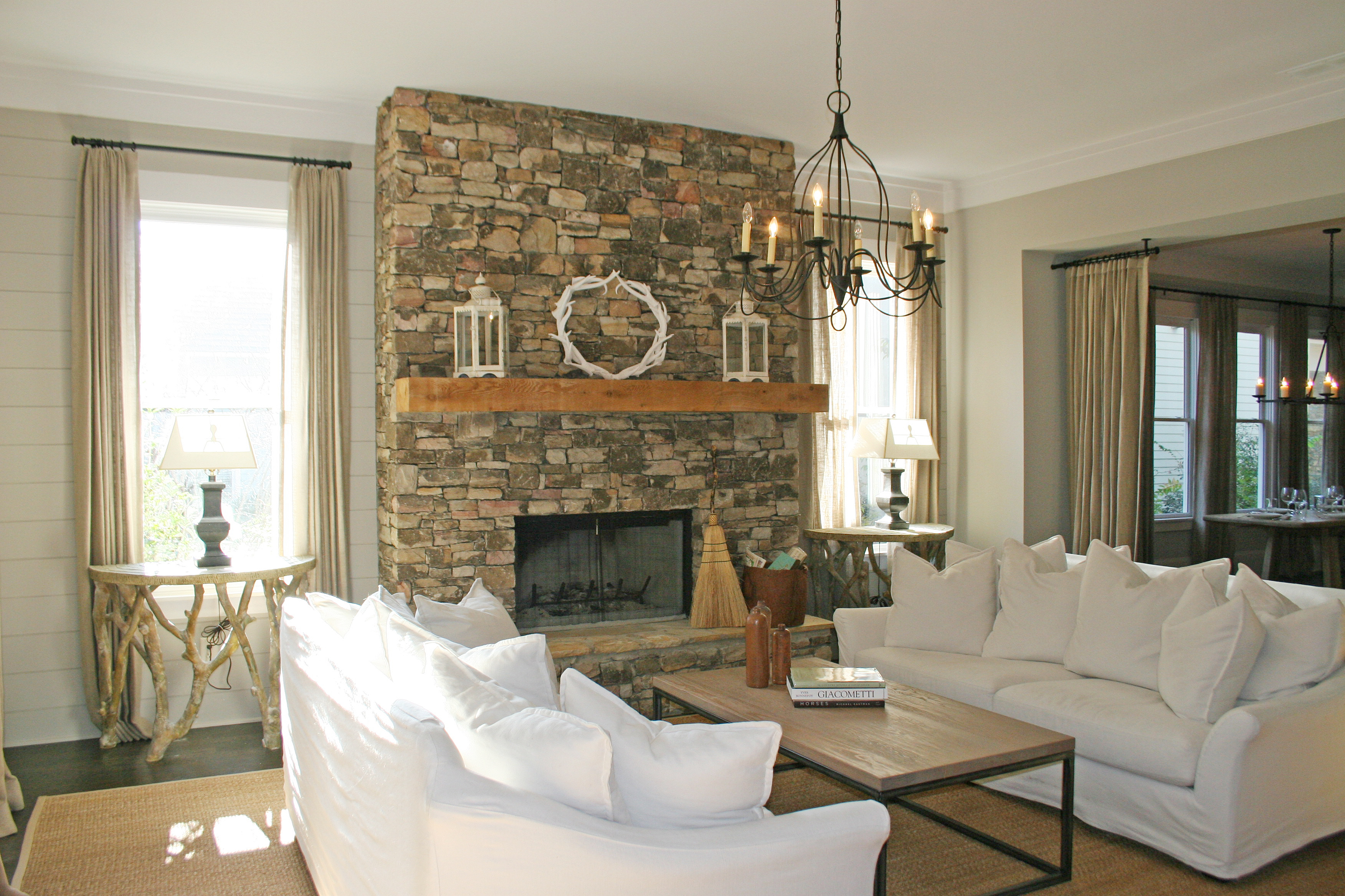 Paint Colors For Family Room With Fireplace Part - 35: Stone Fireplace Sofas Table Pillows Curtains Rug Lamp Chandelier