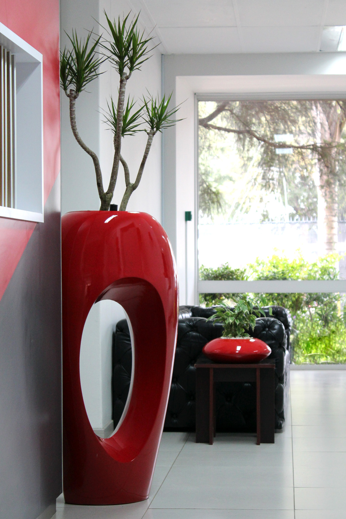 Stylish Red Modern Indoor Pot Design With Unique Plant On White Floor With  Black Seating And