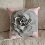 Sweet Light Pink Pillow Idea With Gray Flower Accent On The Surface On Furry White Sofa Idea