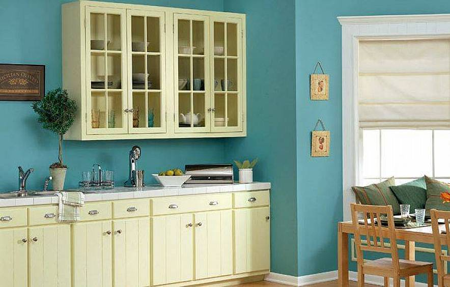 Sweet Painted Blue Color For Kitchen Design With White Cabinetry And  Molding And Wooden Dining Table
