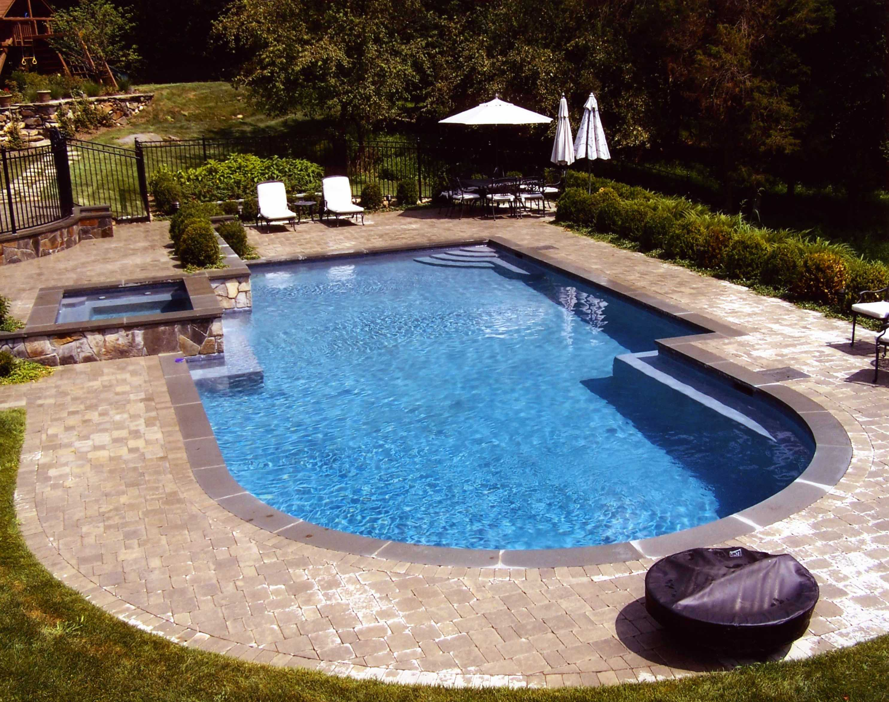 Swimming pool design for your beautiful yard homesfeed for Beautiful swimming pool designs