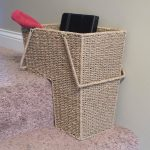 tall shaped basket design for stairs with rattan material for stuff on carpetted steps stairs aside gray wall with handles