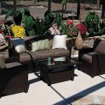 target patio chairs with rattan and brown cushions plus rectangle coffee table with glass top and flower garden