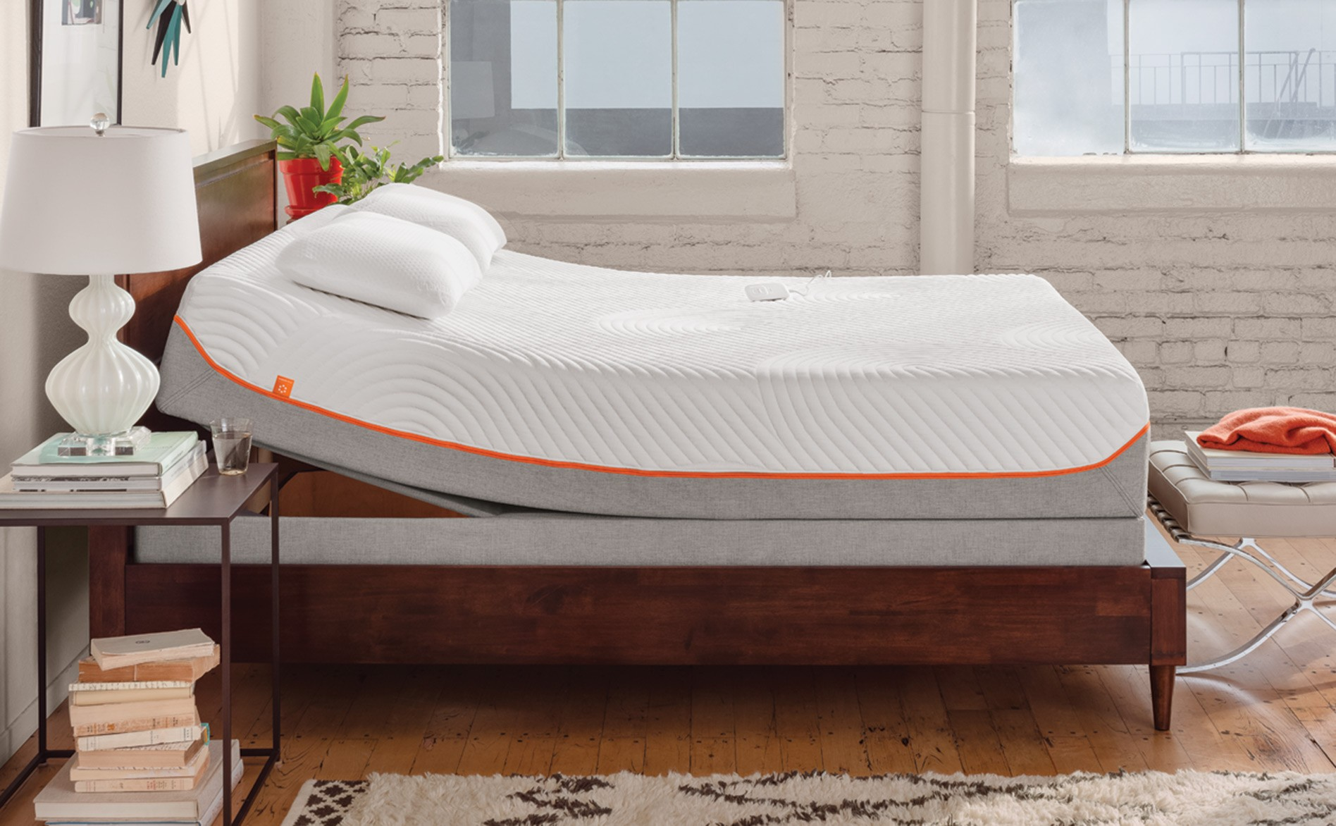 tempurpedic bed rug lamp books table windows pillows