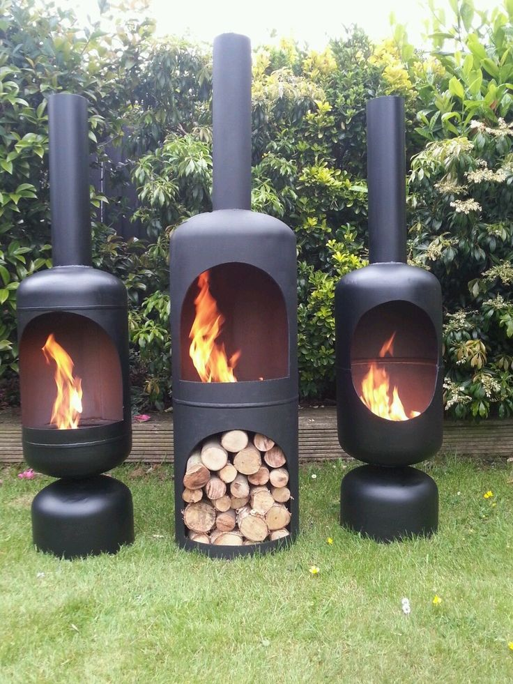 Triple Black Chiminea Fire Pit Idea In Tube Style With No Legs With Chimney  On Grassy