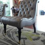 tufted leather slipper chair with black wooden leg for classy living room ideas with grey rug and crystal lamp