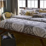 two tones gray motive organic cotton bed sheets yellow cushions bedroom leather chair yellow bedroom rug