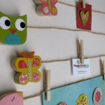 unique and playful kids displaying art idea with owl butterfly and awesome pictures stacked on jute rope