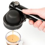 unique and simple hand espresso maker design with black glossy handle and transparent glass cup