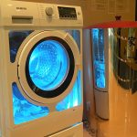 unique and transparent water efficient washing machine design with round door with black accent