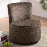 unique armless patterned brown oversized accent chair idea on gray furry rug on wooden floor with books and apples