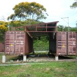 unique brown shipping container shed idea for garade with double designs on grassy meadow