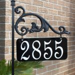 unique frame lawn address signs flower pot placement brick siding house